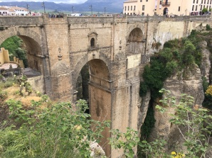 Ancient bridge of Ronda connecting two villages over a deep canyon.